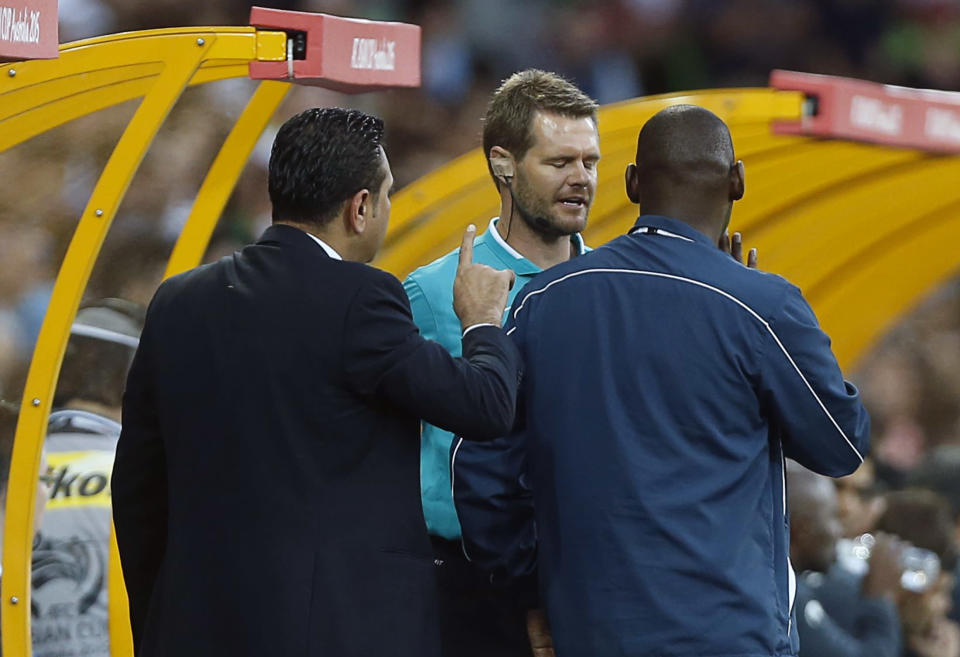 Bahrain's coach Marjan Eid (L) argues with fourth official Christopher Beath of Australia during the Asian Cup Group C soccer match against Iran at the Rectangular stadium in Melbourne January 11, 2015. REUTERS/Brandon Malone (AUSTRALIA - Tags: SOCCER SPORT)