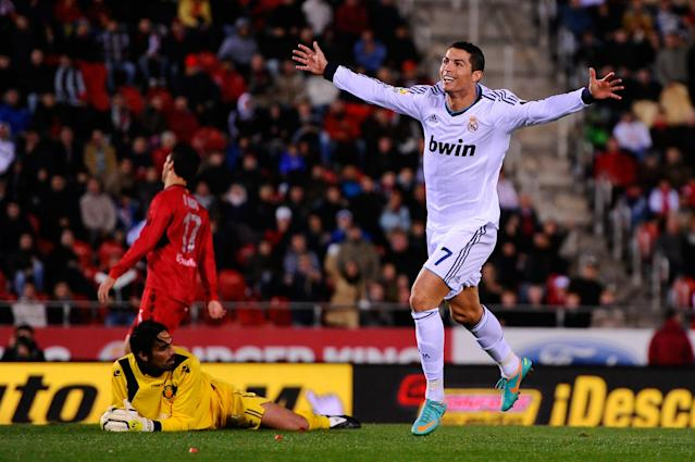 MALLORCA, SPAIN - OCTOBER 28: Cristiano Ronaldo of Real Madrid CF celebrates after scoring his team's fourth goal during the La Liga match between RCD Mallorca and Real Madrid CF at Iberostar Stadium on October 28, 2012 in Mallorca, Spain. Real Madrid CF won 0-5. (Photo by David Ramos/Getty Images)
