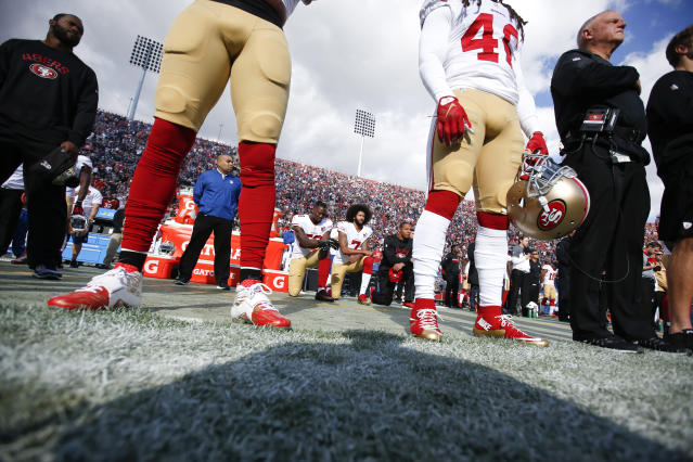 Colin Kaepernick is on the outside looking in at the NFL. (Getty)