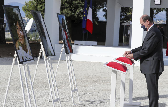 French Prime Minister Jean Castex awards posthumously the victims of a knife attack during a ceremony in Nice, southern France, Saturday Nov. 7, 2020. Three people were killed at Notre-Dame de Nice Basilica on Oct. 29, in an Islamic extremist attack at Notre Dame Basilica in the city of Nice that pushed the country into high security alert. (Valery Hache; Pool via AP)