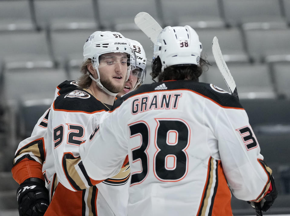 Anaheim Ducks right wing Alexander Volkov (92) is congratulated by Derek Grant (38) after scoring a goal against the San Jose Sharks during the second period of an NHL hockey game Wednesday, April 14, 2021, in San Jose, Calif. (AP Photo/Tony Avelar)