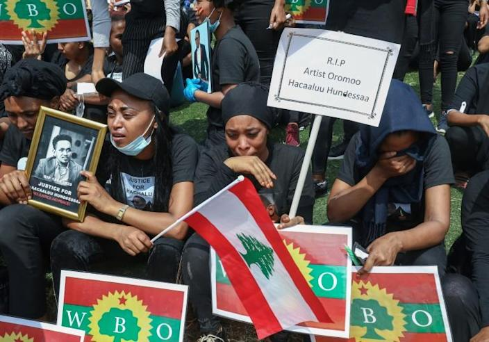 Protesters in Beirut hold pictures of Oromo singer Hachalu Hundessa, whose death sparked violence in Ethiopia (AFP Photo/ANWAR AMRO)