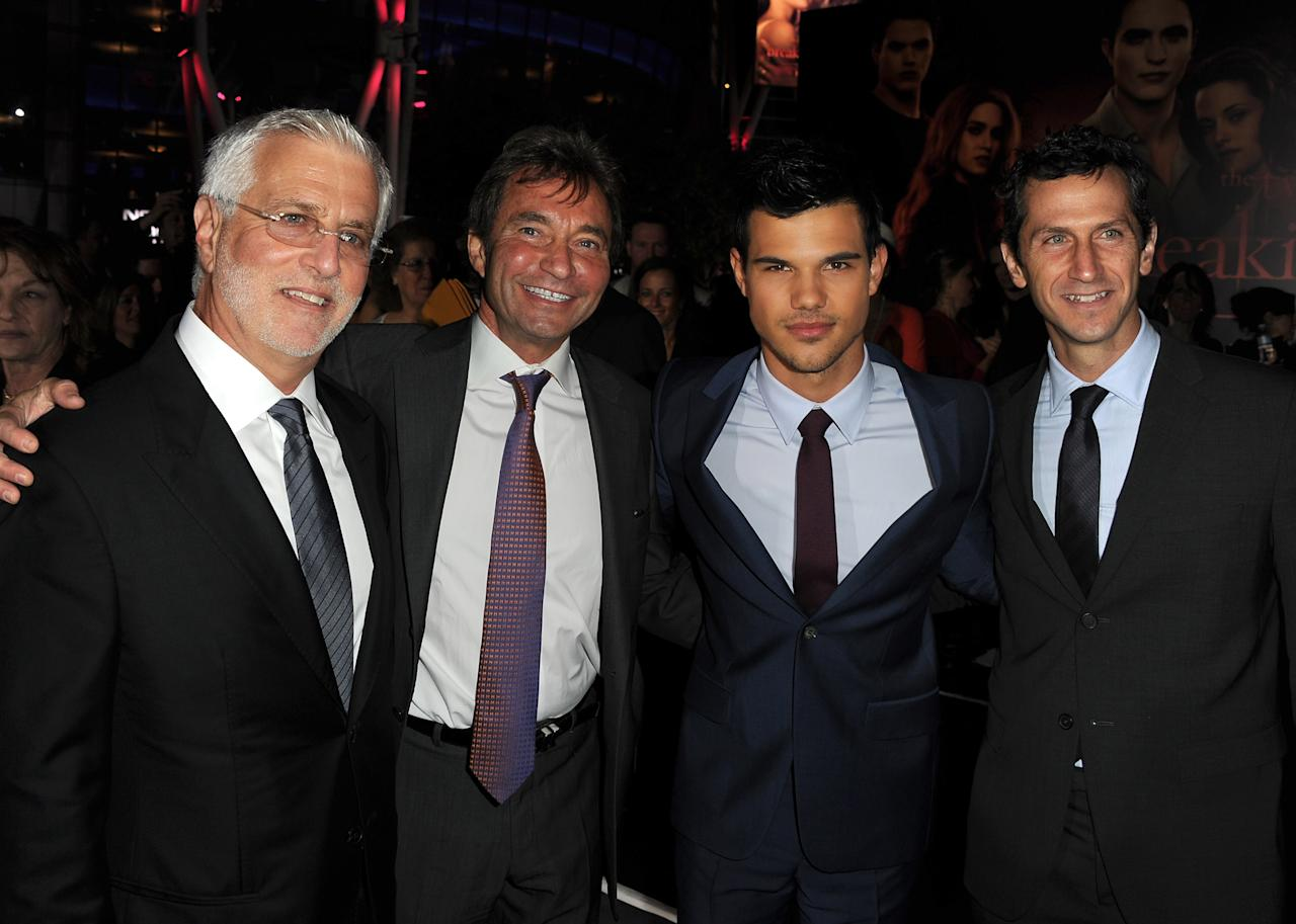 "LOS ANGELES, CA - NOVEMBER 14:  (L-R) Summit Entertainment Co-Chairman Rob Friedman, Summit Entertainment President & CEO Patrick Wachsberger, actor Taylor Lautner, and Summit Entertainment President of Worldwide Production and Acquisitions Erik Feig arrive at the premiere of Summit Entertainment's ""The Twilight Saga: Breaking Dawn - Part 1"" at Nokia Theatre L.A. Live on November 14, 2011 in Los Angeles, California.  (Photo by Kevin Winter/Getty Images)"