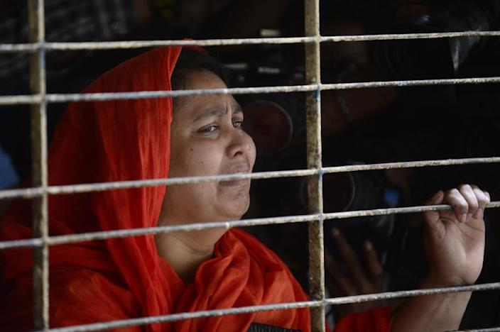 A relative of dead Bangladeshi blogger Washiqur Rahman reacts after seeing his body at Dhaka Medical College in Dhaka on March 30, 2015, after he was killed in an attack in the Bangladeshi capital (AFP Photo/Munir Uz Zaman)