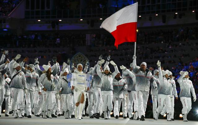 Poland's flag-bearer Dawid Kupczyk leads his country's contingent during the opening ceremony of the 2014 Sochi Winter Olympic Games at Fisht stadium February 7, 2014. REUTERS/Brian Snyder (RUSSIA - Tags: OLYMPICS SPORT)