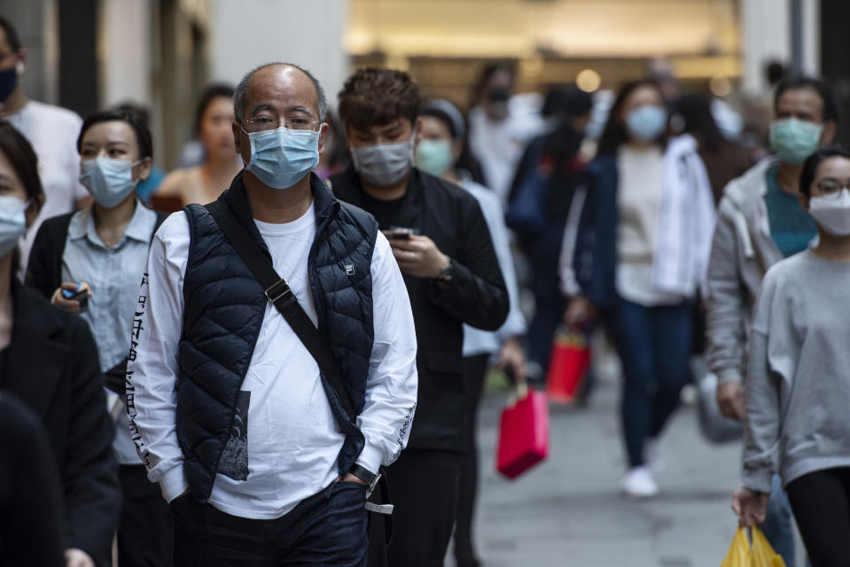 Pedestrians wearing face masks as a preventive measure against the Coronavirus, official name covid-19, seen in Central district in Hong Kong. (Photo by Miguel Candela / SOPA Images/Sipa USA)