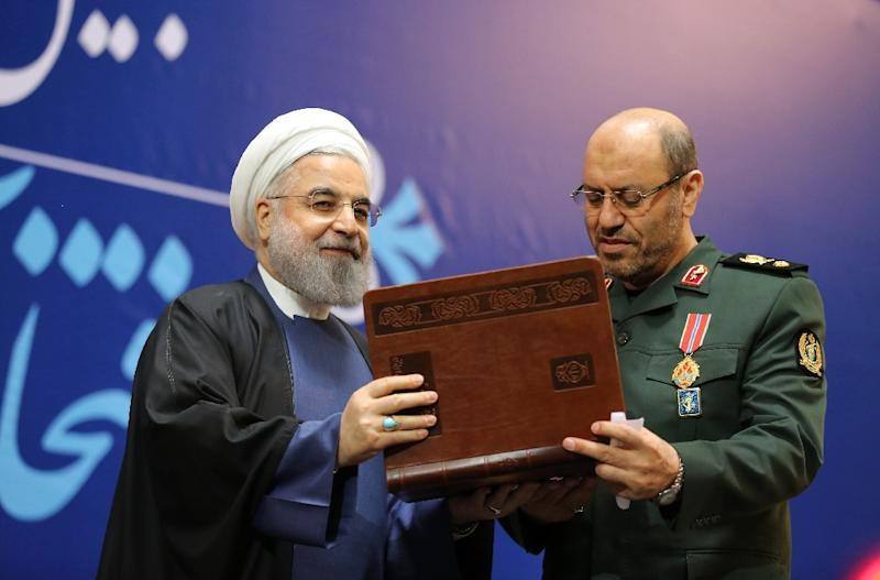 Iranian President Hassan Rouhani awards Iran's Defence Minister Hossein Dehghan (right) with the Medal of Honour for his role in the implementation of a nuclear deal with world powers, in Tehran on February 8, 2016