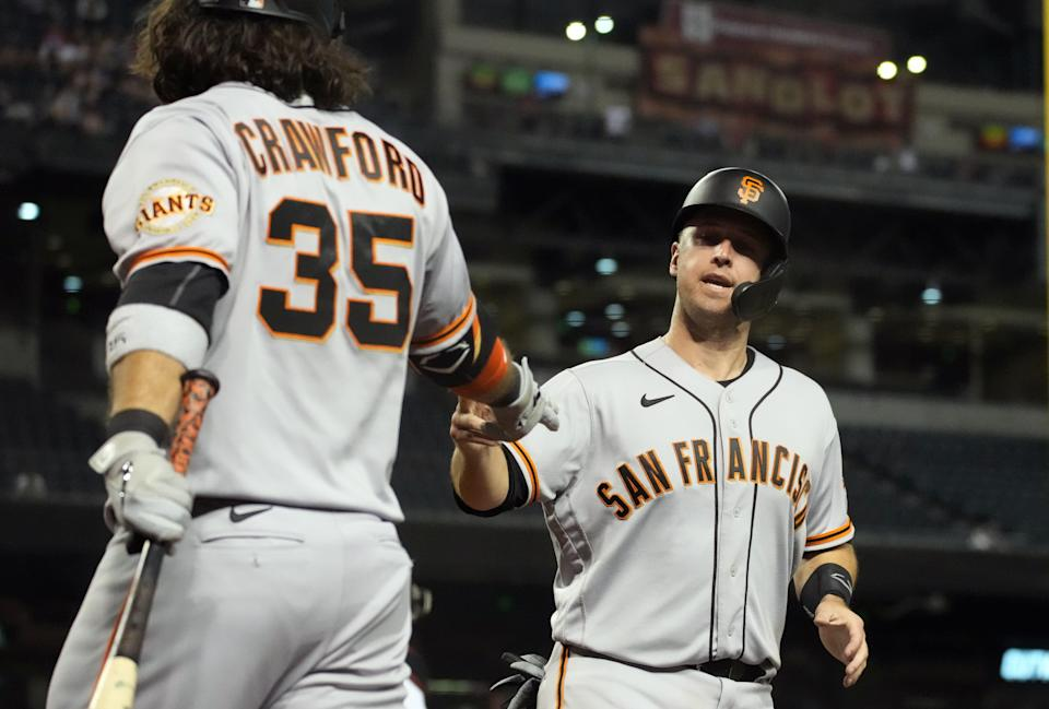 Crawford and Posey have led the Giants to the top of the NL West in 2021.