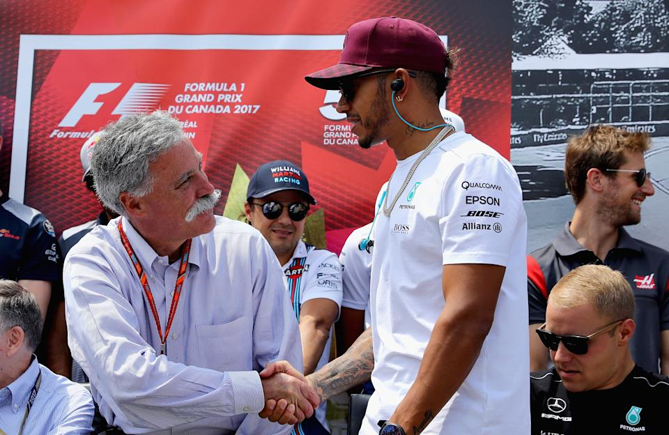 MONTREAL, QC - JUNE 11: Chase Carey, CEO and Executive Chairman of the Formula One Group shakes hands with Lewis Hamilton of Great Britain and Mercedes GP before the Canadian Formula One Grand Prix at Circuit Gilles Villeneuve on June 11, 2017 in Montreal, Canada.  (Photo by Clive Mason/Getty Images)