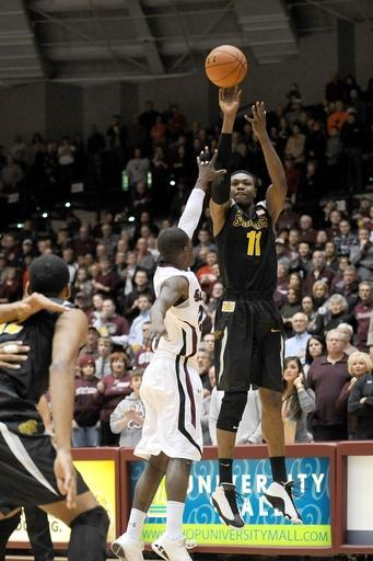 Wichita State's Cleanthony Early (11) shoots over Southern Illinois' Marcus Fillyaw during the first period of a Missouri Valley Conference NCAA college basketball game in Carbondale, Ill., Thursday, Jan. 2, 2014. (AP Photo/Stephen Lance Dennee)