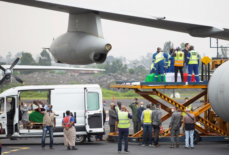 Officials load the bodies of the slain Italian ambassador to Democratic Republic of Congo Luca Attanasio and his Italian security Vittorio Iacovacci, at the Goma International Airport