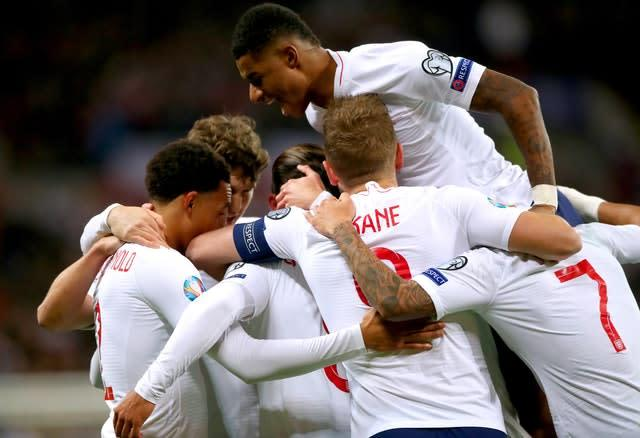 England players celebrate as team-mate Alex Oxlade-Chamberlain scores their opening goal (Nick Potts/PA)