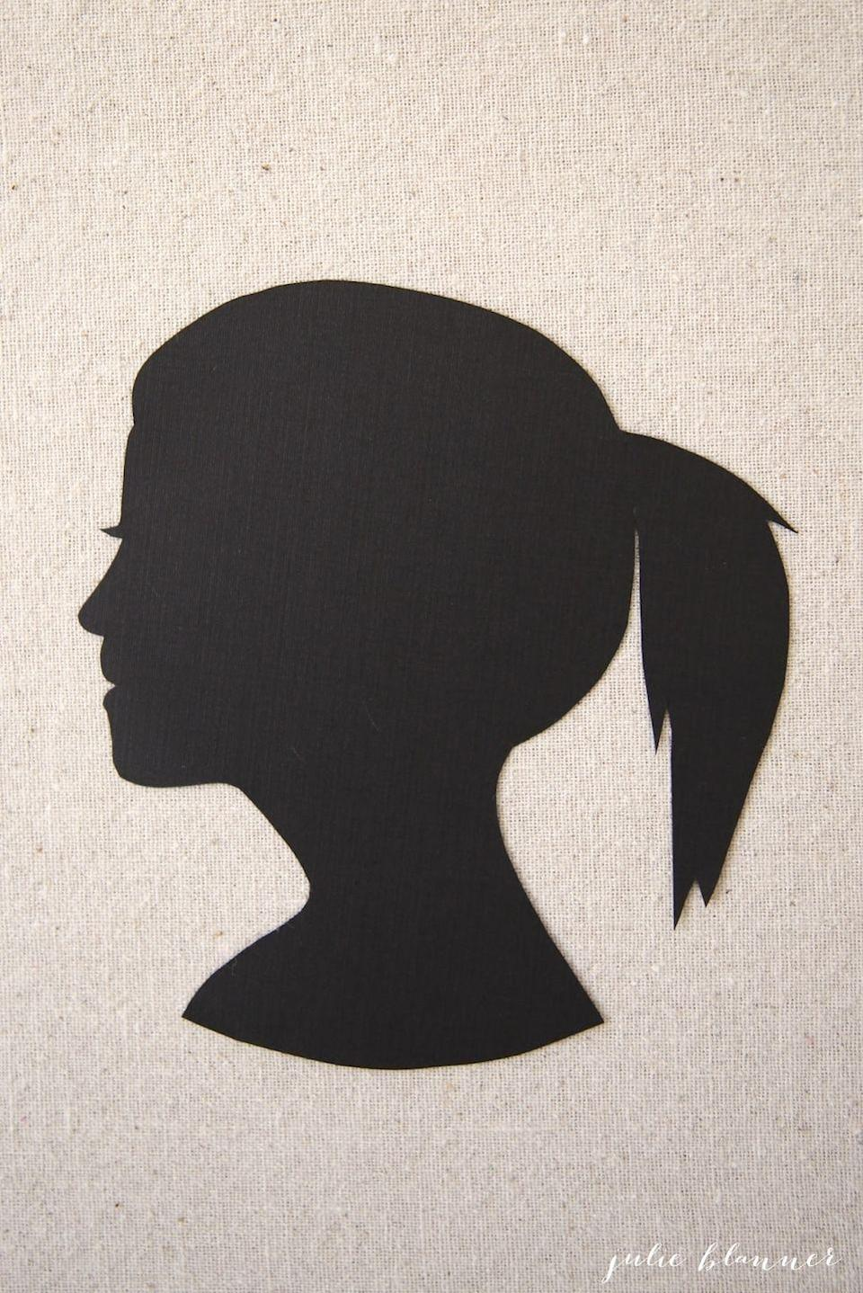 """<p>Need to fill up a blank wall? Create this inexpensive and darling silhouette portrait of any member of the family (even Fluffy!). It makes a perfect gift for grandparents, too!</p><p><strong>Get the tutorial at <a href=""""https://julieblanner.com/silhouette-portrait/"""" rel=""""nofollow noopener"""" target=""""_blank"""" data-ylk=""""slk:Julie Blanner"""" class=""""link rapid-noclick-resp"""">Julie Blanner</a>. </strong></p><p><a class=""""link rapid-noclick-resp"""" href=""""https://www.amazon.com/Darice-Coredinations-Cardstock-12-Inch-20-Pack/dp/B0086XIB68/ref=sr_1_5?dchild=1&keywords=black+cardstock&qid=1600884080&s=home-garden&sr=1-5&tag=syn-yahoo-20&ascsubtag=%5Bartid%7C10050.g.23489557%5Bsrc%7Cyahoo-us"""" rel=""""nofollow noopener"""" target=""""_blank"""" data-ylk=""""slk:SHOP BLACK CARDSTOCK"""">SHOP BLACK CARDSTOCK</a></p>"""
