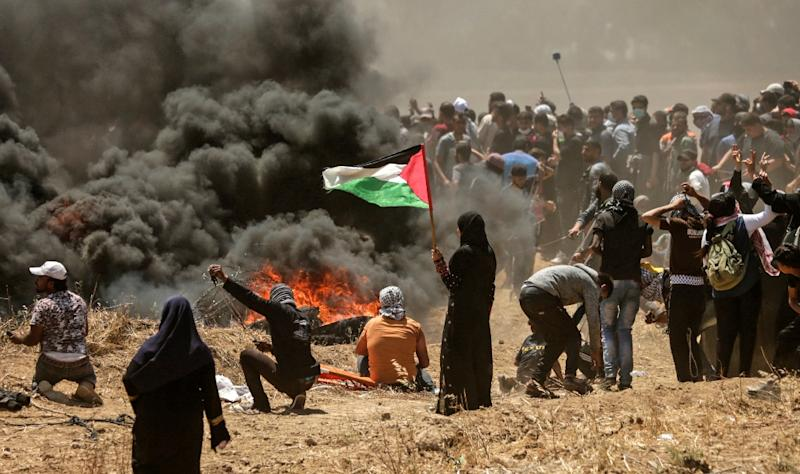 Israel killed 60 Palestinians during protests on the Gaza border as the US relocated its embassy from Tel Aviv to Jerusalem (AFP Photo/MAHMUD HAMS)