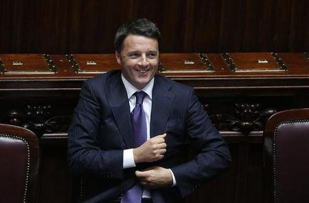 Italian Prime Minister Matteo Renzi smiles after he delivered his speech at the Italian Parliament in Rome