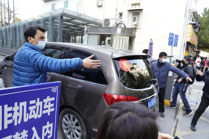A car that's part of a convoy carrying the World Health Organization team of researchers arrives at the Hubei Provincial Hospital of Integrated Chinese and Western Medicine also known as the Hubei Province Xinhua Hospital in Wuhan in central China's Hubei province Friday, Jan. 29, 2021. The World Health Organization team of researchers emerged from their hotel Thursday for the first time since their arrival in the central Chinese city of Wuhan to start searching for clues into the origins of the COVID-19 pandemic. (AP Photo/Ng Han Guan)