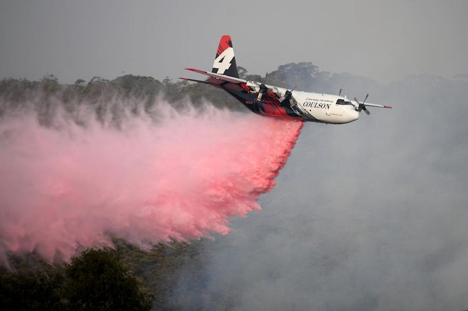 The NSW RFS Large Air Tanker drops fire retardant in the NSW Southern Highlands during the Australian bushfires
