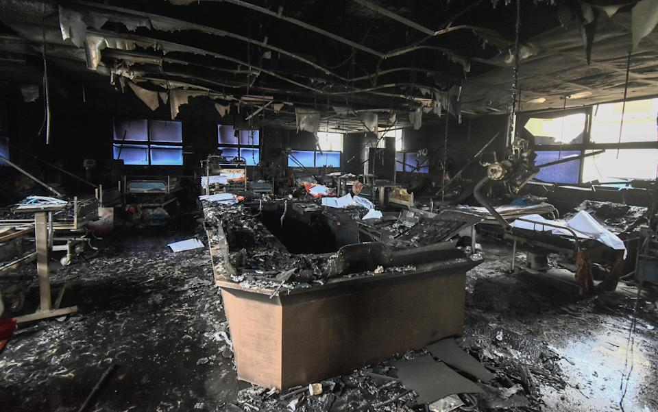 Thirteen COVID-19 patients died in a fire at the intensive care unit of a private hospital in Palghar district of Maharashtra on Friday. Photo: Yahoo India/Stringer in Mumbai