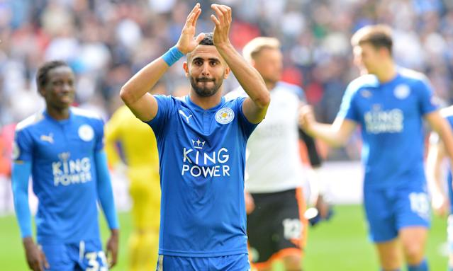 Riyad Mahrez applauds the travelling Leicester fans after the club's final Premier League match of the season against Tottenham.