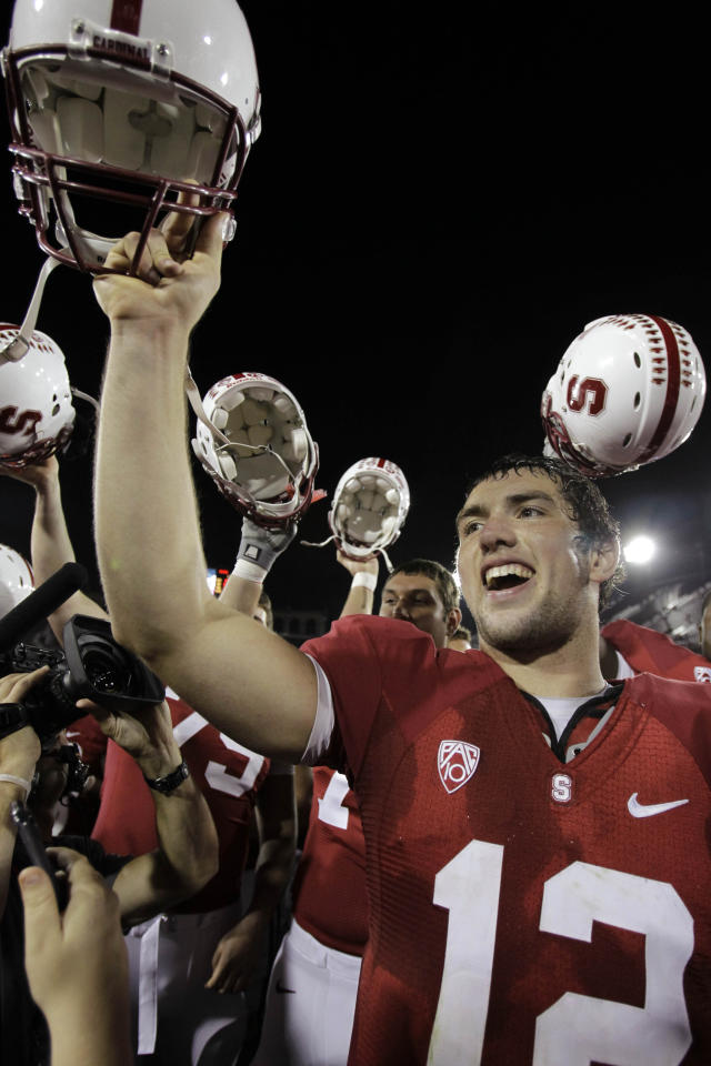 FILE - This Nov. 6, 2010 file photo shows Stanford quarterback Andrew Luck (12) celebrating after Stanford defeated Arizona 42-17 in an NCAA college football game in Stanford, Calif. A person with direct knowledge of the situation says the Indianapolis Colts are taking Luck with the No. 1 pick in next week's NFL draft. (AP Photo/Paul Sakuma, File)