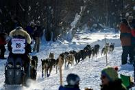 Michelle Phillips leaves in the Iditarod Sled Dog Race
