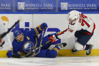 Buffalo Sabres forward Sam Reinhart (23) and Washington Capitals forward Conor Sheary (73) collide during the second period of an NHL hockey game Friday, Jan. 15, 2021, in Buffalo, N.Y. (AP Photo/Jeffrey T. Barnes)