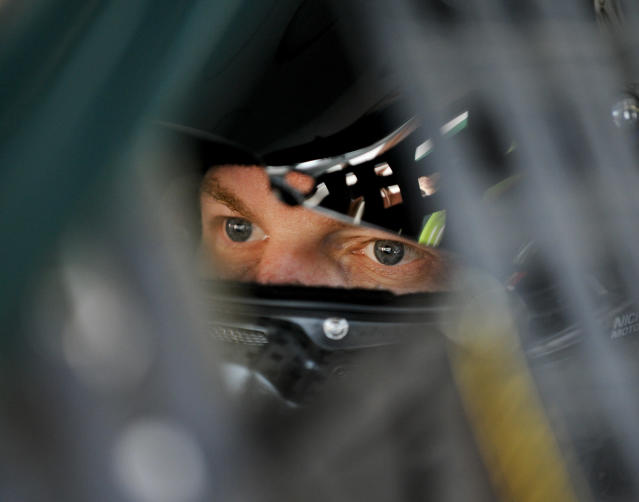Dale Earnhardt Jr. sits in his car as he waits to practice for Sunday's NASCAR Geico 500 Sprint Cup Series auto race at Talladega Superspeedway, Friday, Oct. 17, 2014, in Talladega, Ala. (AP Photo/Rainier Ehrhardt)