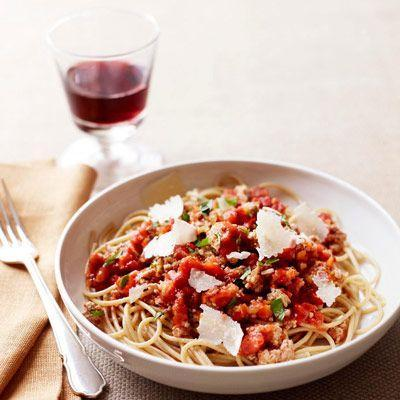 """<p>This Bolognese comes together in just 30 minutes. But it's so bursting with flavor you might think it took all day.</p><p><strong><a href=""""https://www.countryliving.com/food-drinks/recipes/a21915/turkey-spaghetti-bolognese-recipe/"""" rel=""""nofollow noopener"""" target=""""_blank"""" data-ylk=""""slk:Get the recipe"""" class=""""link rapid-noclick-resp"""">Get the recipe</a>.</strong></p><p><a class=""""link rapid-noclick-resp"""" href=""""https://www.amazon.com/Patented-Strainer-Handles-Nonstick-Ti-Cerama/dp/B071L32Q8W/?tag=syn-yahoo-20&ascsubtag=%5Bartid%7C10050.g.31929300%5Bsrc%7Cyahoo-us"""" rel=""""nofollow noopener"""" target=""""_blank"""" data-ylk=""""slk:SHOP PASTA POTS"""">SHOP PASTA POTS</a></p>"""