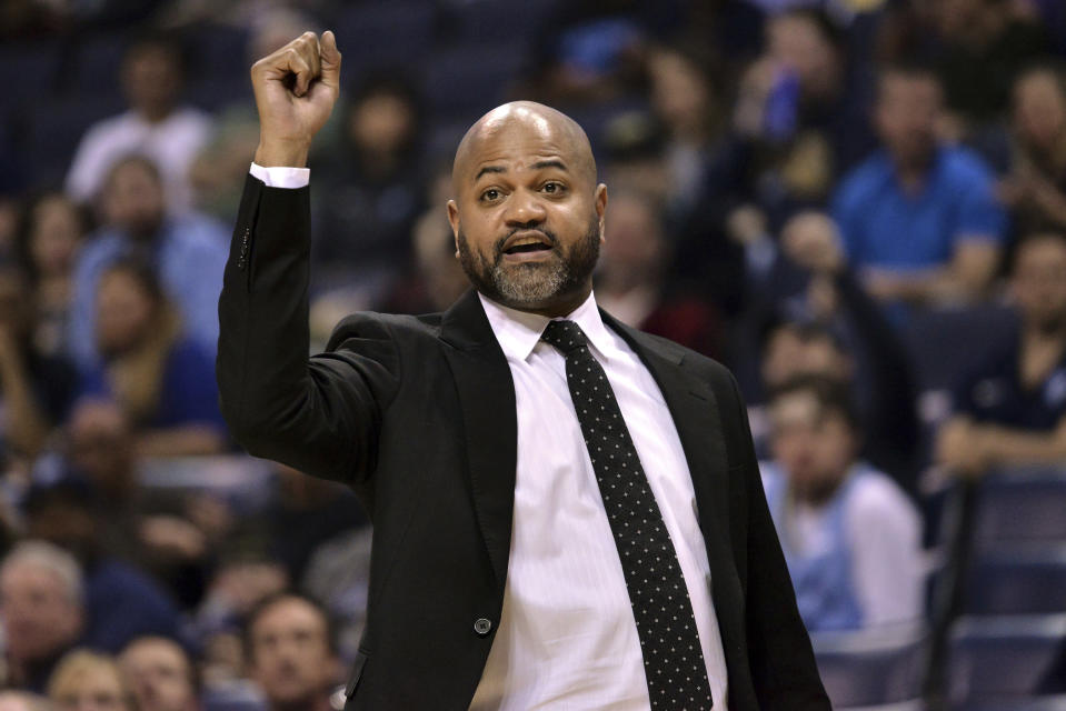 FILE - In this March 23, 2019, file photo, Memphis Grizzlies head coach J.B. Bickerstaff calls to players in the first half of an NBA basketball game against the Minnesota Timberwolves, in Memphis, Tenn. The Cavaliers have added former Grizzlies coach J.B. Bickerstaff to John Beilein's staff as an associate head coach. Bickerstaff was a candidate for Cleveland's opening and interviewed for the job before the Cavs lured Beilein away from Michigan after a successful 12-year run. Bickerstaff was fired in April by Memphis following a disappointing 33-49 season. Bickerstaff's father, Bernie, is a senior adviser with the Cavs. (AP Photo/Brandon Dill, File)