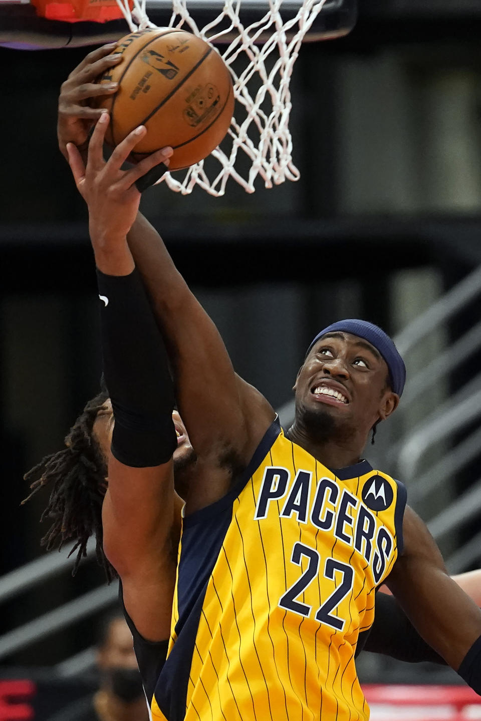 Indiana Pacers guard Caris LeVert (22) grabs a rebound away from Toronto Raptors forward Freddie Gillespie (55) during the first half of an NBA basketball game Sunday, May 16, 2021, in Tampa, Fla. (AP Photo/Chris O'Meara)