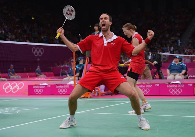 LONDON, ENGLAND - AUGUST 01: Joachim Fischer and Christinna Pedersen of Denmark celebrate beating Sudket Prapakamol and Saralee Thoungthongkam in their Mixed Doubles Badminton on Day 5 of the London 2012 Olympic Games at Wembley Arena at Wembley Arena on August 1, 2012 in London, England. (Photo by Michael Regan/Getty Images)