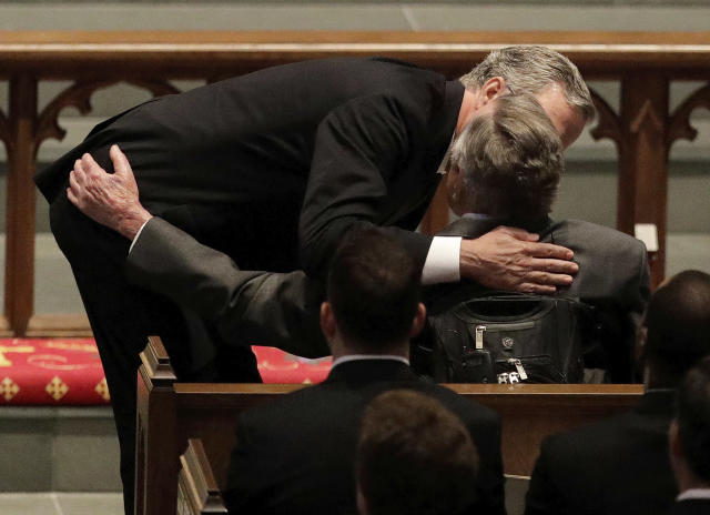 <p>Former Florida Governor Jeb Bush comforts his father, former President George H.W. Bush during a funeral service for his mother, former first lady Barbara Bush at St. Martin's Episcopal Church, Saturday, April 21, 2018, in Houston. (Photo: David J. Phillip, Pool/AP) </p>