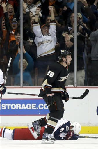 Anaheim Ducks left wing Matt Beleskey (39) celebrates teammate Ryan Getzlaf's goal in front of Columbus Blue Jackets defenseman Nikita Nikitin (6), of Russia, during the first period of an NHL hockey game in Anaheim, Calif. on Monday, Feb. 18, 2013. (AP Photo/Chris Carlson)