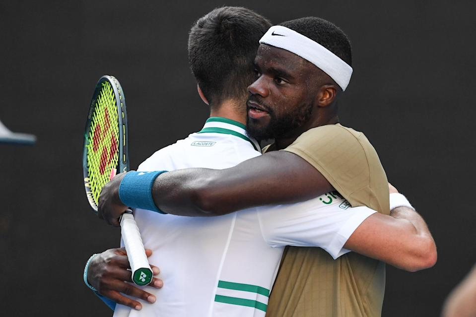 Frances Tiafoe, right, who pushed Novak Djokovic, left, to four sets in this year's Australian Open, would have a strong chance of beating him during the Tokyo Olympics.