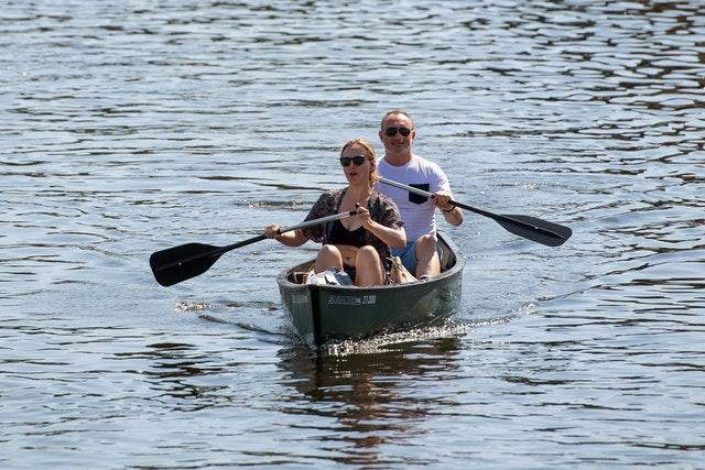 People canoe along the River Bure at Wroxham on the Norfolk Broads