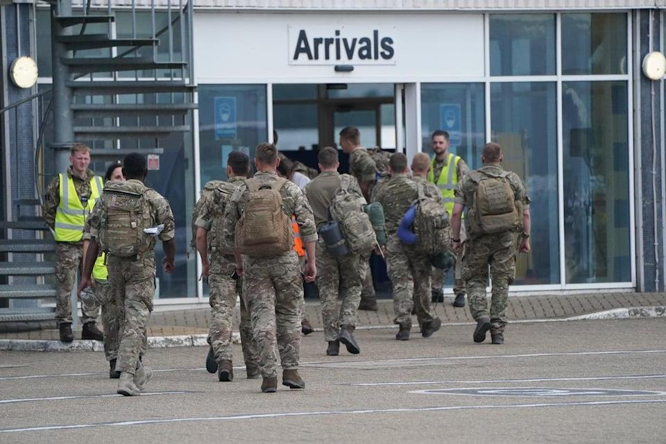 Members of the British armed forces 16 Air Assault Brigade walk to the air terminal after departing a flight from Afghanistan at RAF Brize Norton, Oxfordshire (Jonathan Brady/PA) (PA Wire)