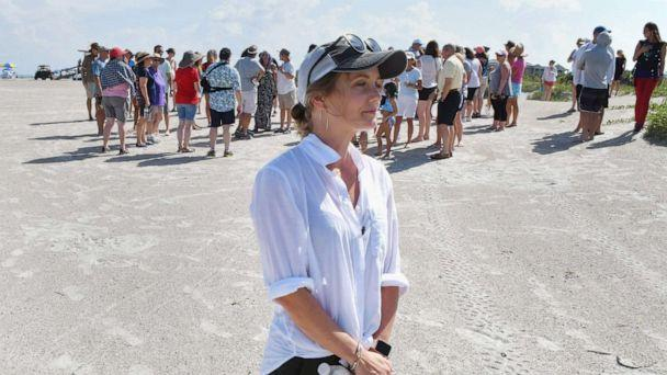 PHOTO: Stephanie Young McCluney, wife of Brian McCluney, one of two missing boaters, is joined by supporters at Jetty Park, Aug. 18, 2019, to pray and search the shore clues to the missing boaters who left Port Canaveral two days earlier. (Tim Short/Florida Today via Imagn)