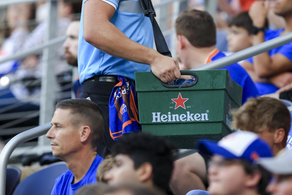 Jun 19, 2021; Cincinnati, OH, USA; A view of vendor carrying a Heineken container in the stands in the game between the Colorado Rapids and FC Cincinnati at TQL Stadium. Mandatory Credit: Aaron Doster-USA TODAY Sports/Sipa USA