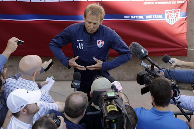 U.S. men's soccer coach Jurgen Klinsmann answers questions during training camp in preparation for the World Cup, Wednesday, May 21, 2014, in Stanford, Calif
