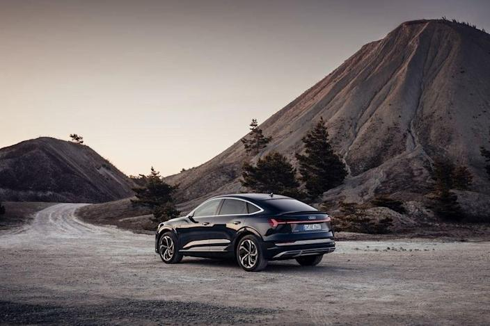 """Audi has been on <a href=""""https://www.architecturaldigest.com/story/mercedes-eqc-audi-e-tron-new-tesla-fighters?mbid=synd_yahoo_rss"""" rel=""""nofollow noopener"""" target=""""_blank"""" data-ylk=""""slk:an EV push this year"""" class=""""link rapid-noclick-resp"""">an EV push this year</a>, and it is demonstrating no sign of letting up. This shapely """"coupe-style"""" SUV sacrifices some rear headroom and cargo space for a seductive profile. We're willing to make that sacrifice, too."""
