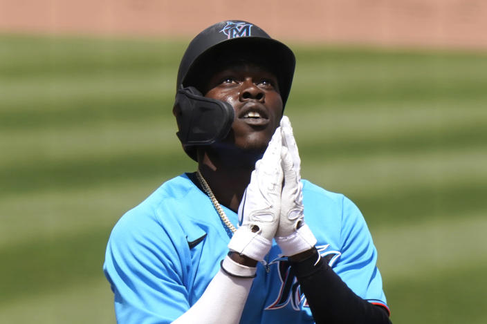 Miami Marlins' Jazz Chisholm reacts as he crosses home plate after hitting a solo home run during the fifth inning of a spring training baseball game against the New York Mets, Wednesday, March 17, 2021, in Jupiter, Fla. (AP Photo/Lynne Sladky)