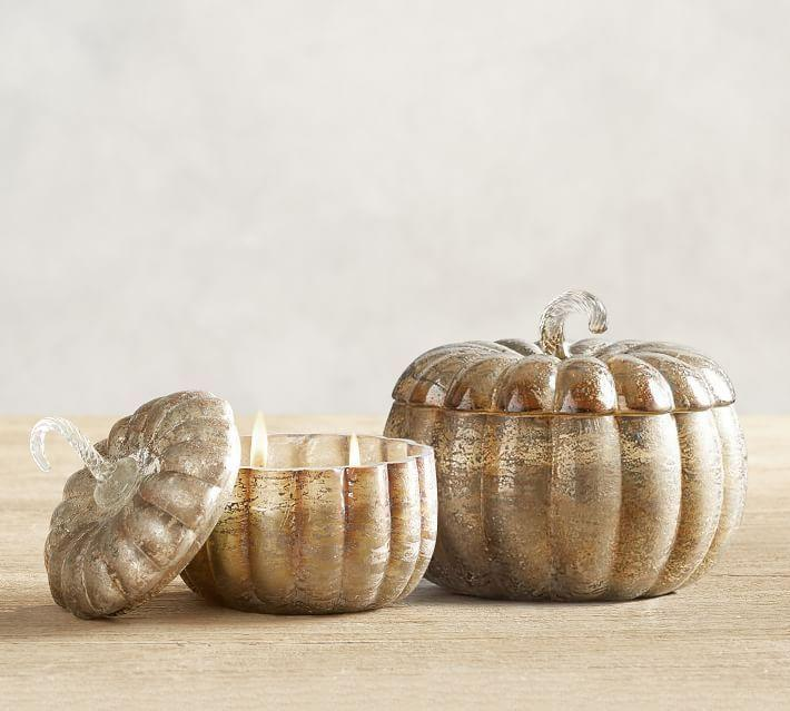 """<p><strong>Shop the complete Halloween Collection</strong></p><p>potterybarn.com</p><p><strong>$49.50</strong></p><p><a href=""""https://go.redirectingat.com?id=74968X1596630&url=https%3A%2F%2Fwww.potterybarn.com%2Fproducts%2Fmercury-lided-pumpkin-candle-pot-harvest-spice%2F&sref=https%3A%2F%2Fwww.countryliving.com%2Fdiy-crafts%2Fg2655%2Fseasonal-candles%2F"""" rel=""""nofollow noopener"""" target=""""_blank"""" data-ylk=""""slk:Shop Now"""" class=""""link rapid-noclick-resp"""">Shop Now</a></p><p>This mercury glass pumpkin, filled with a Harvest Spice-scented candle, will fit in nicely with any fall tablescape.</p>"""