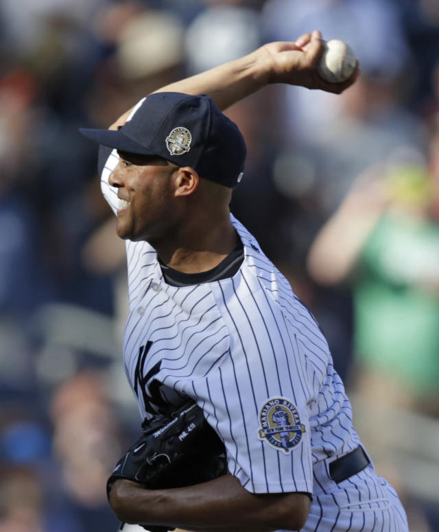New York Yankees relief pitcher Mariano Rivera delivers in the ninth inning of a baseball game against the San Francisco Giants, Sunday, Sept. 22, 2013, in New York. (AP Photo/Kathy Willens)