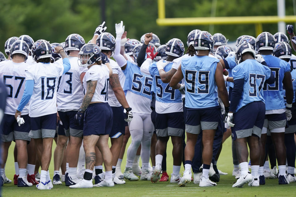 Tennessee Titans players gather during NFL football practice Thursday, June 3, 2021, in Nashville, Tenn. (AP Photo/Mark Humphrey, Pool)