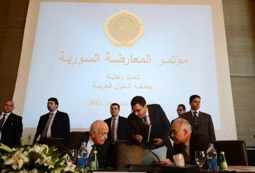 "Arab League chief Nabil al-Arabi (front left) speaks with Egypt's Foreign Minister Mohammed Kamel Amr during the Syrian Opposition Conference in Cairo. Exiled opposition groups tried to forge a common vision for a transition in Syria as they met Monday in Cairo as the UN rights chief accused both the regime and opposition of ""serious"" violations"