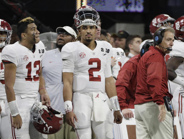 "Alabama's <a class=""link rapid-noclick-resp"" href=""/ncaaf/players/264323/"" data-ylk=""slk:Jalen Hurts"">Jalen Hurts</a> (2) is seen on the bench with <a class=""link rapid-noclick-resp"" href=""/ncaaf/players/274844/"" data-ylk=""slk:Tua Tagovailoa"">Tua Tagovailoa</a> (13) head coach Nick Saban during the second half of the NCAA college football playoff championship game against Georgia Monday, Jan. 8, 2018, in Atlanta. (AP Photo/David J. Phillip)"