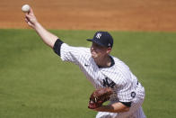 New York Yankees' Michael King delivers a pitch during the first inning of a spring baseball game against the Toronto Blue Jays Sunday, Feb. 28, 2021, in Tampa, Fla. (AP Photo/Frank Franklin II)