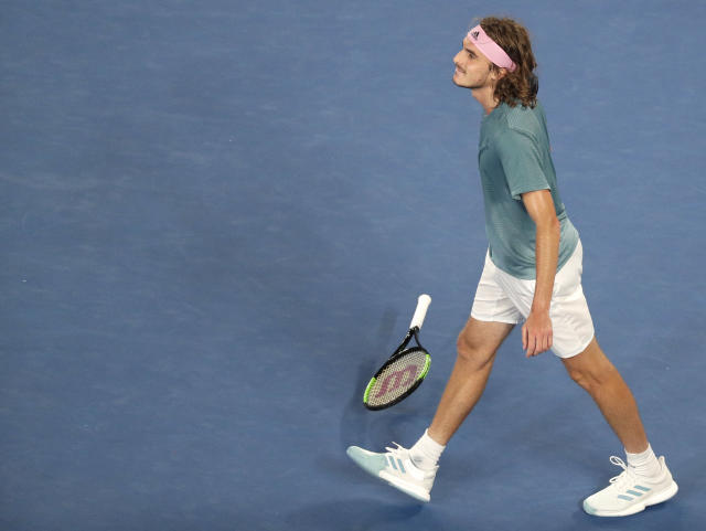 Greece's Stefanos Tsitsipas celebrates after defeating Switzerland's Roger Federer in their fourth round match at the Australian Open tennis championships in Melbourne, Australia, Sunday, Jan. 20, 2019.(AP Photo/Kin Cheung)