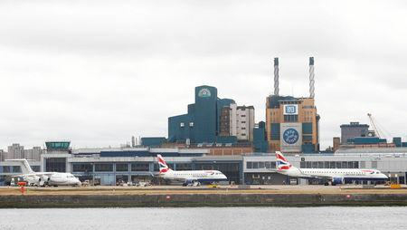 FILE PHOTO: Aircraft stand idle at City Airport after a protest closed the runway causing flights to be delayed, in London