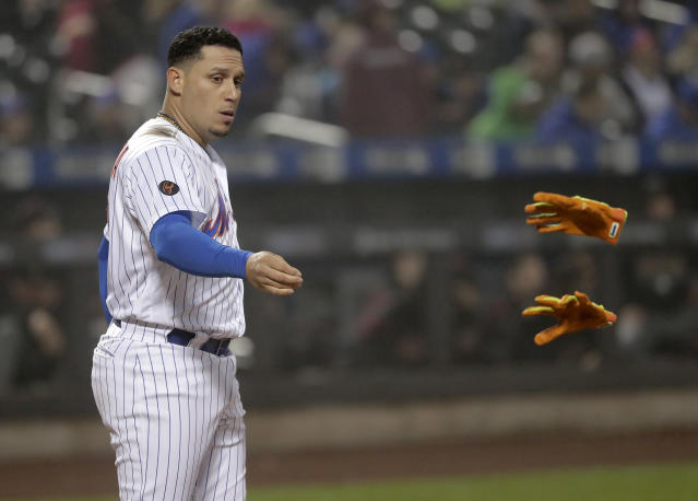 New York Mets' Asdrubal Cabrera tosses his batting gloves after striking out to end the fifth inning of a baseball game against the Arizona Diamondbacks, Saturday, May 19, 2018, in New York. (AP Photo/Julie Jacobson)